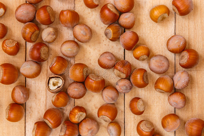 Nuts on wooden boards royalty free stock photography