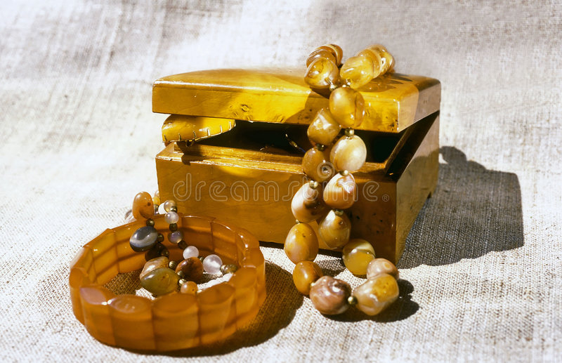 Nutwood casket and amber adornment stock photos