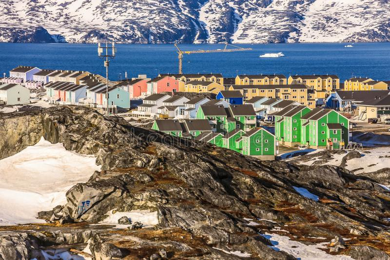 Nuuk city with colorful houses covered in snow with sea fjord an. D mountains in the background, Greenland stock photography