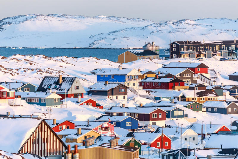 Nuuk city covered in snow with sea and mountains stock image