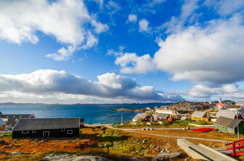 Nuuk city old harbor fjord panorama with clouds over the blue sk. Y in the background, Greenland royalty free stock image