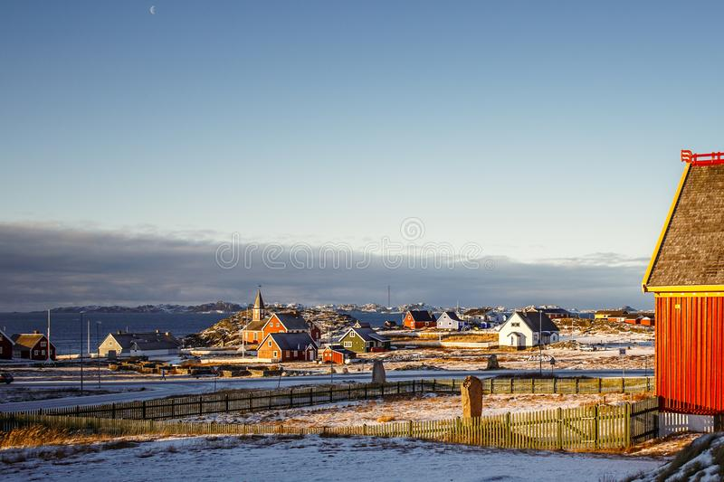 Nuuk city suburb with Inuit houses with sea and the fjord background, Greenland stock image