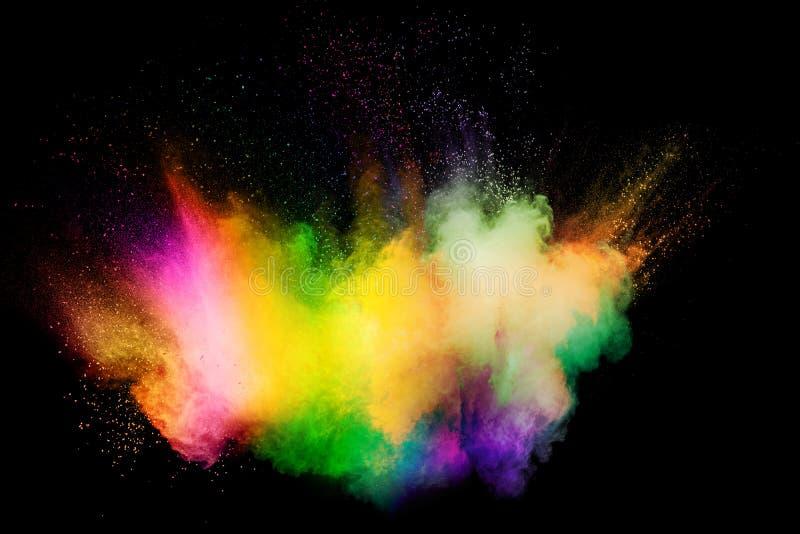 Nuvem da explos?o do p? da cor no fundo preto Movimento do gelo do espirro das part?culas de poeira da cor imagem de stock