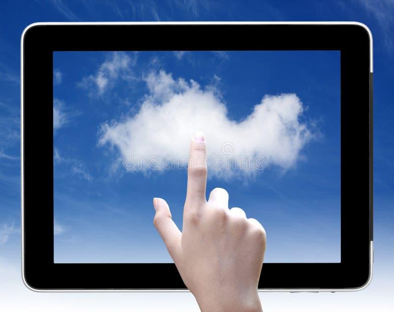 Nuvem do toque da mão no PC da tabuleta fotografia de stock