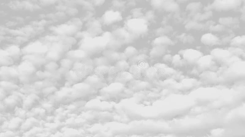 Nuvens brancas em um fundo cinzento foto de stock royalty free