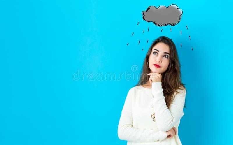 Nuvola di pioggia con la giovane donna immagini stock