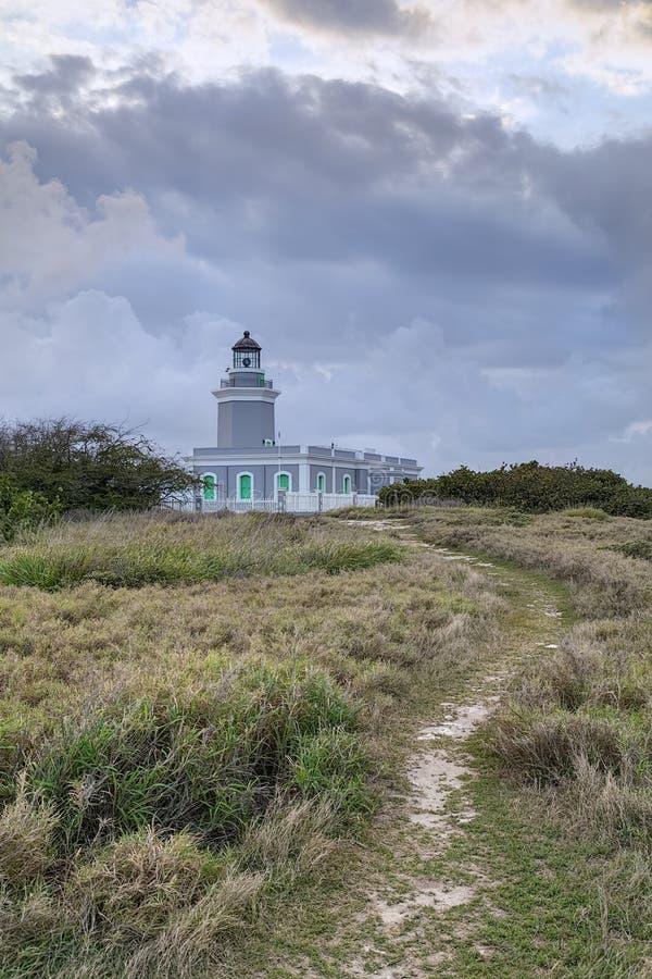 Nuvole sopra il faro di Los Morrillos, Cabo Rojo, Porto Rico immagine stock libera da diritti