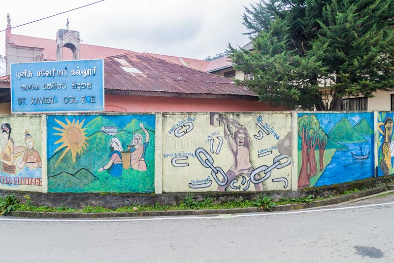 NUWARA ELIYA, SRI LANKA - JULI 16, 2016: Färgrika väggmålningar på en vägg av högskolan för St Xaviers i Nuwara Eliya släp fotografering för bildbyråer