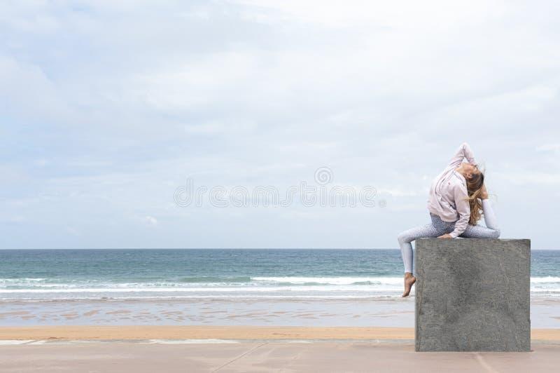 NWoman yogi doing the pigeon pose royalty free stock photos