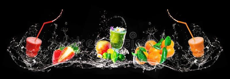 Ny blandning av smoothies och frukt som plaskar, baner royaltyfri bild