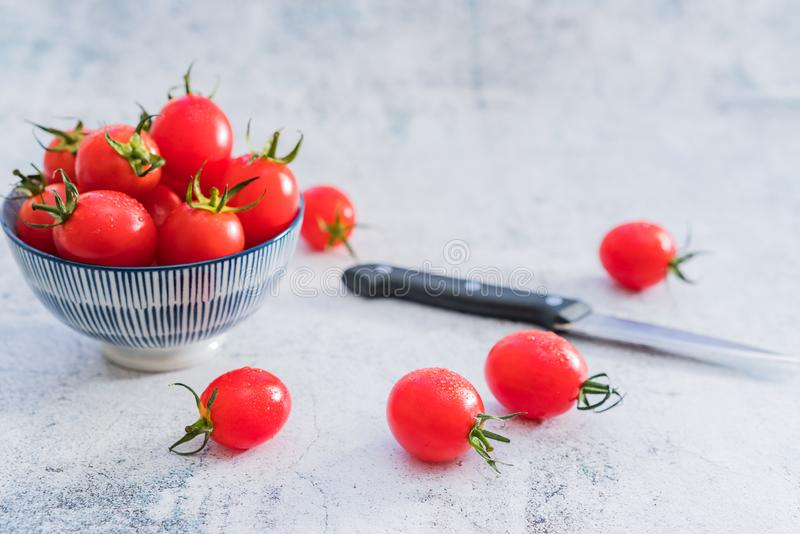 Ny Cherry Tomatoes One Night Under vit bakgrund royaltyfria foton