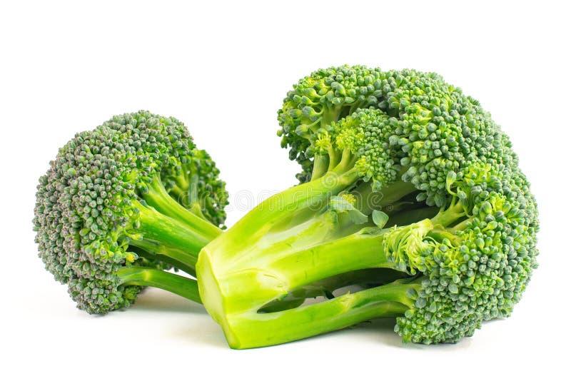 Ny grön broccoli som isoleras på vit bakgrund royaltyfri bild