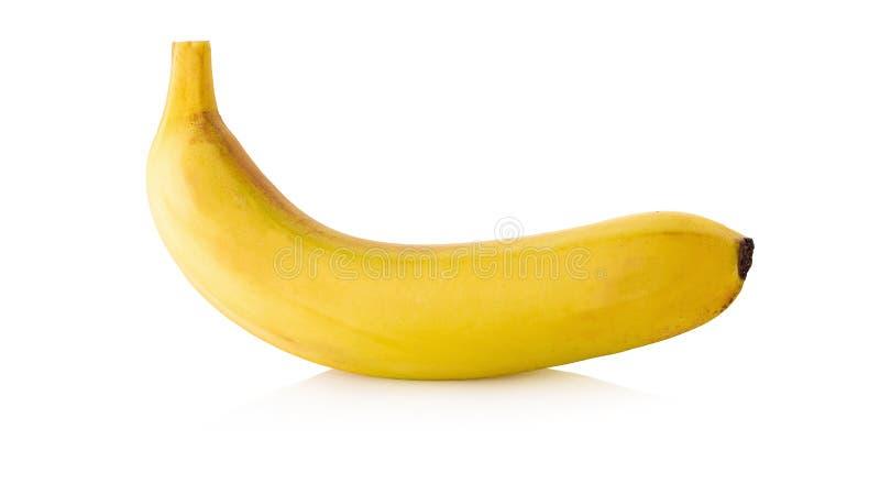 Ny gul ljus banan som isoleras över en vit bakgrund arkivfoton