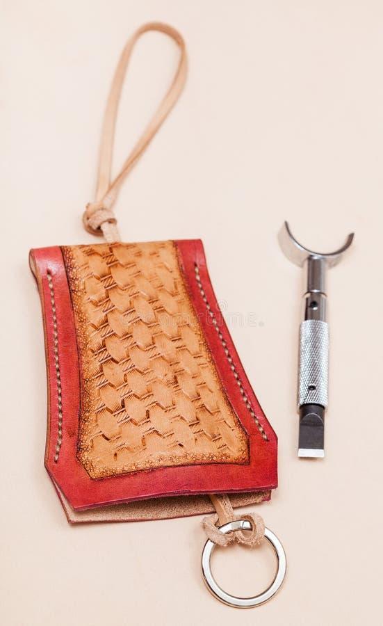 Ny hand - gjord sniden läderhandväska för tangenter royaltyfri foto