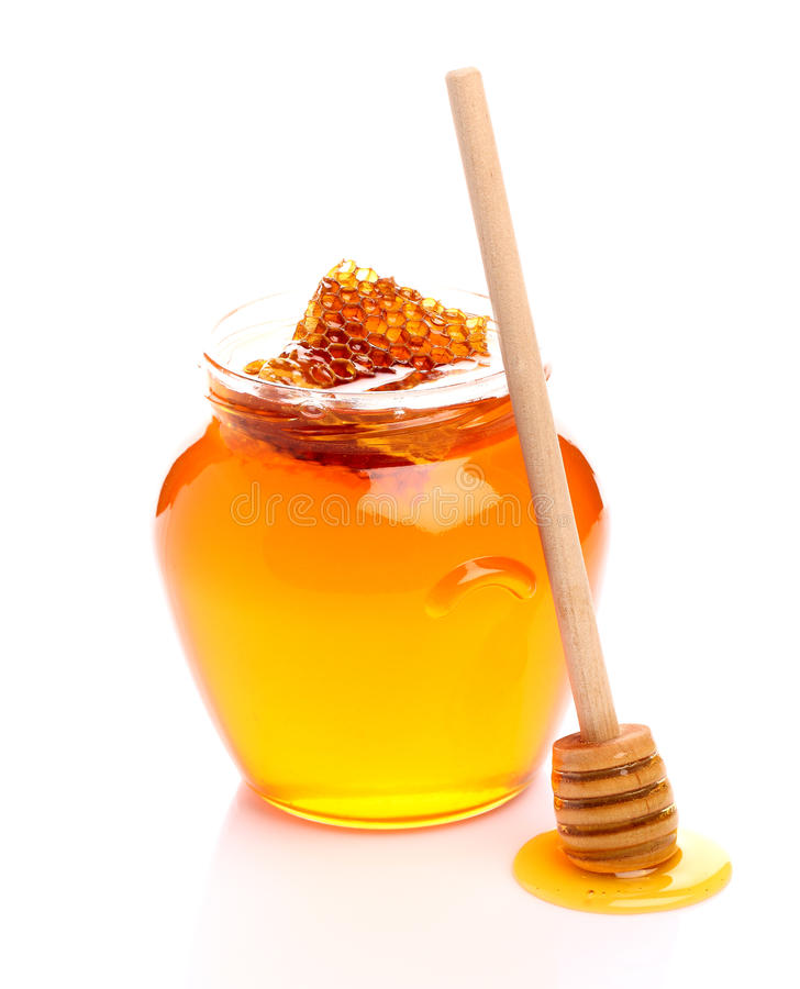Ny honung med honungskakan royaltyfri fotografi