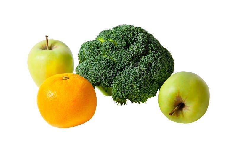 Ny kombination av den isolerade äpplet, broccoli och apelsinen arkivbilder