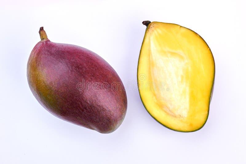 Ny mango klippta itu delar arkivfoto
