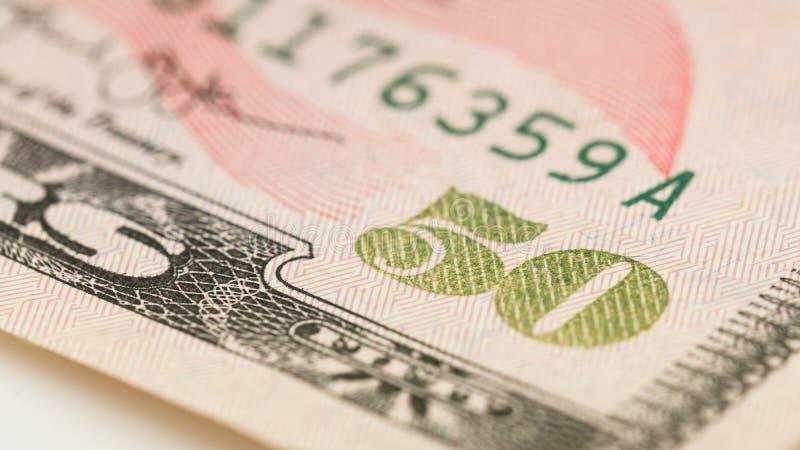 Ny och gammal amerikansk dollarräkning för pengar femtio för Closeup USA makro för 50 dollar sedelfragment arkivfoto