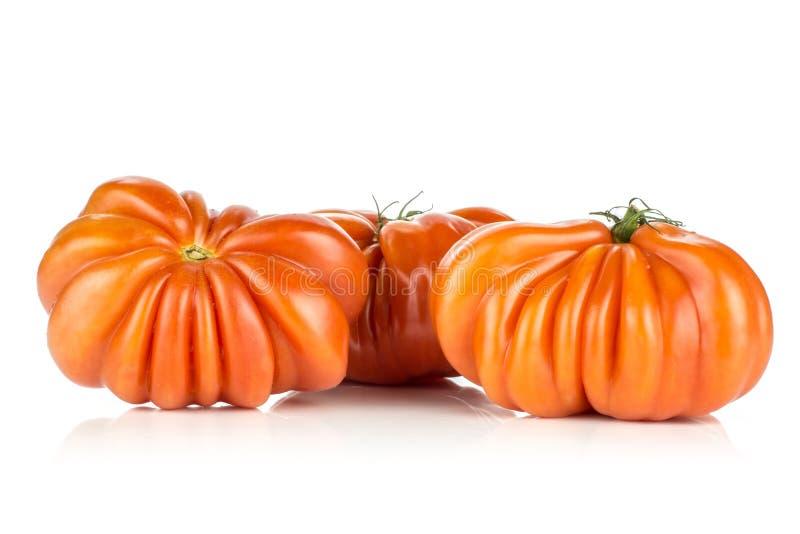 Ny rå variation för tomatnötkötttomat som isoleras på vit arkivfoton