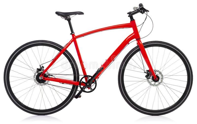 Ny röd cykel som isoleras på en vit royaltyfri fotografi