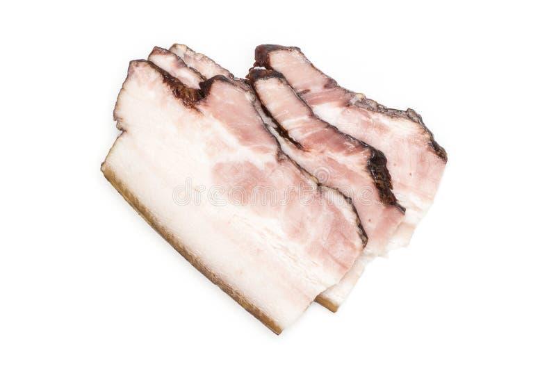 Ny rökt engelsk bacon som isoleras på vit fotografering för bildbyråer