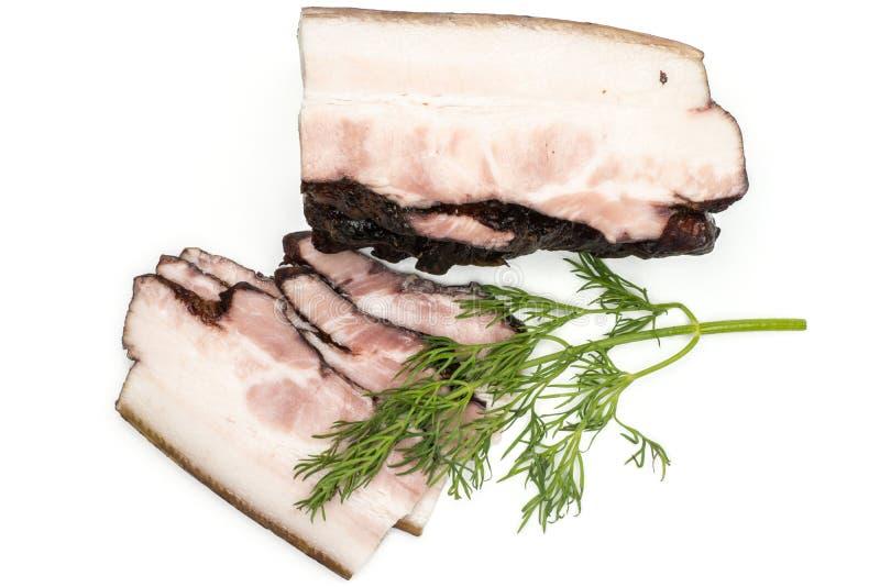 Ny rökt engelsk bacon som isoleras på vit royaltyfri foto