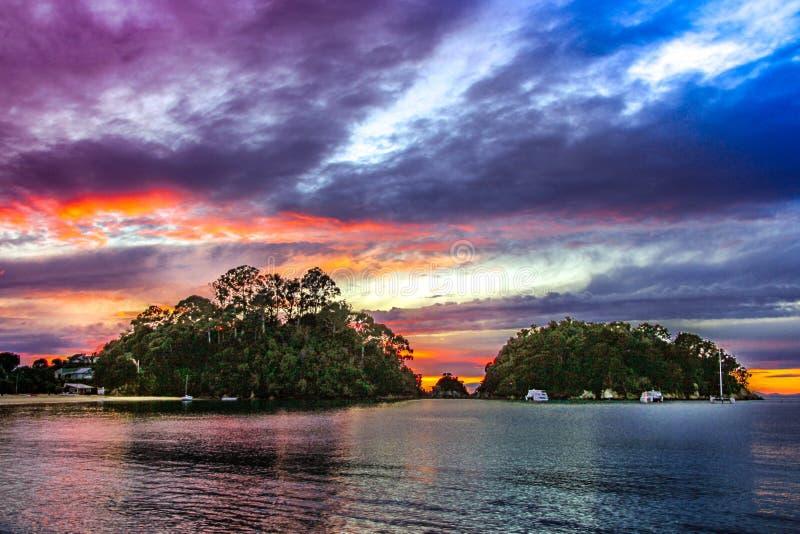 ny solnedgång zealand arkivbild