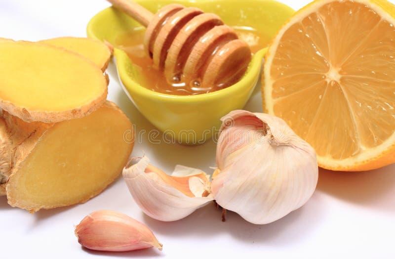 Nya frukter och grönsaker med honung, sunda produkter royaltyfri foto