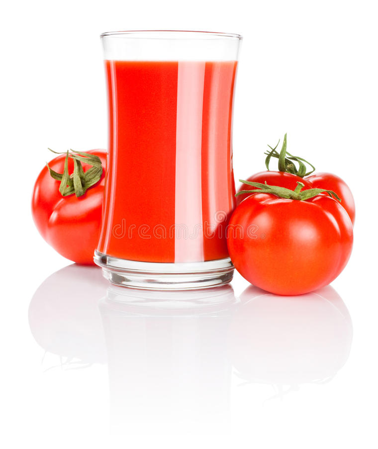 nya glass tomattomater för fruktsaft tre arkivfoto