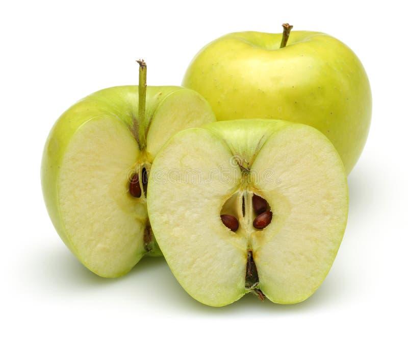 Nya guld- äpplen som isoleras på vit arkivbilder
