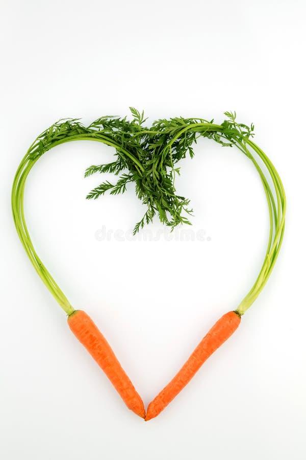 Nya morötter i hjärtaform arkivbild