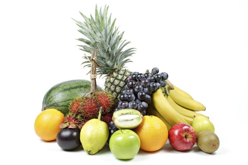 Nya olika frukter på isolerad vit bakgrund royaltyfria foton