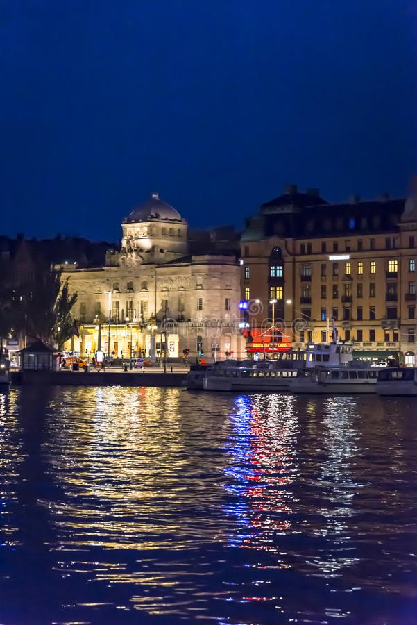 Nybroplan area in Ostermalm district with Royal Dramatic Theatre at night, Stockholm, Sweden royalty free stock photos