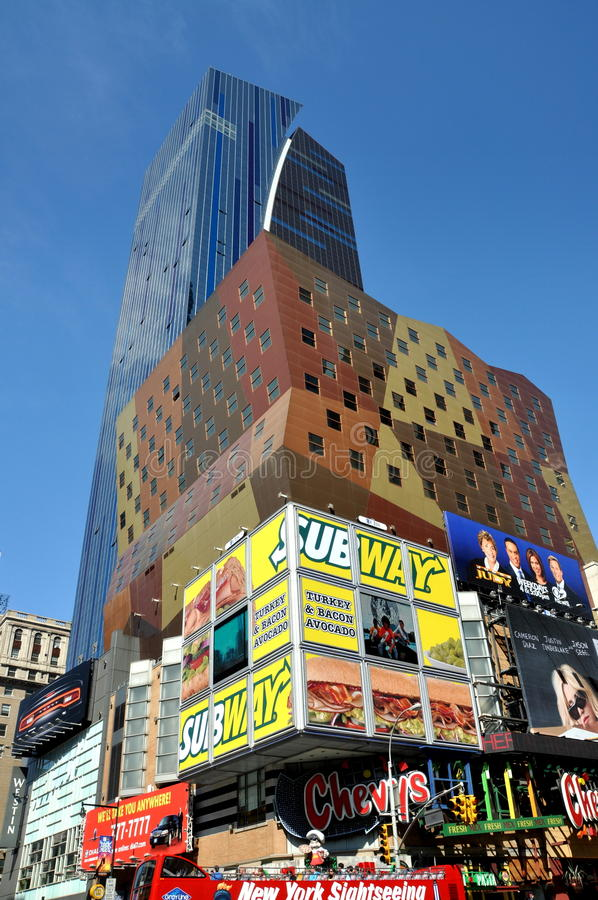 NYC: 42nd Street and Westin Hotel. Giant billboards for various local restaurants plaster the walls of buildings at the corner of fabled West 42nd Street and 8th stock photos
