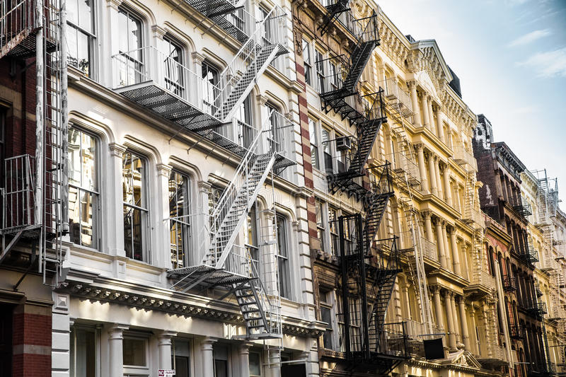 NYC Apartment Building Facade. New York City view of exterior facade on ornate old apartment building residence with fire escapes seen from lower Manhattan, NYC royalty free stock photo