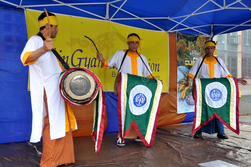 NYC: Burmese Drummers. Three drummers wearing traditional robes and saffron headbands performing at the opening ceremonies of the 16th annual ThinGyan Burmese stock photo