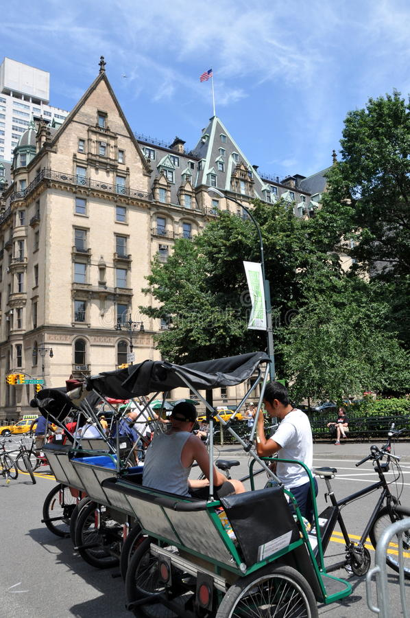 NYC: Central Park Pedicabs. Pedicab drivers talking with one another to pass the time while waiting for a fare just inside Central Park at West 72nd Street with royalty free stock photos