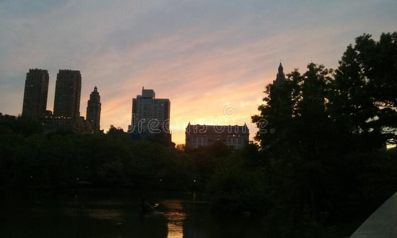 Nyc Central Park solnedgångmagi New York City arkivfoto