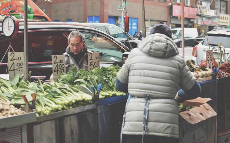 NYC Chinatown Fruit Vendor Stand Chinese People Selling Street Fruits and Vegetable stock image