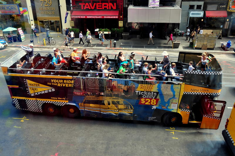 NYC: Double Decker Tourist Bus in Times Square royalty free stock image