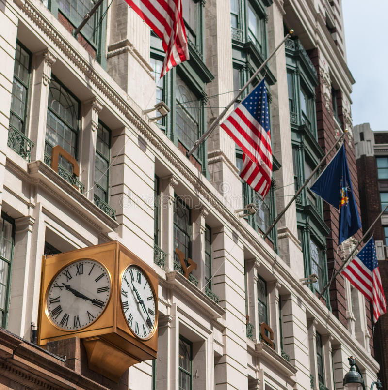 NYC facade with flags. Facade with American flags, NYC downtown stock photography