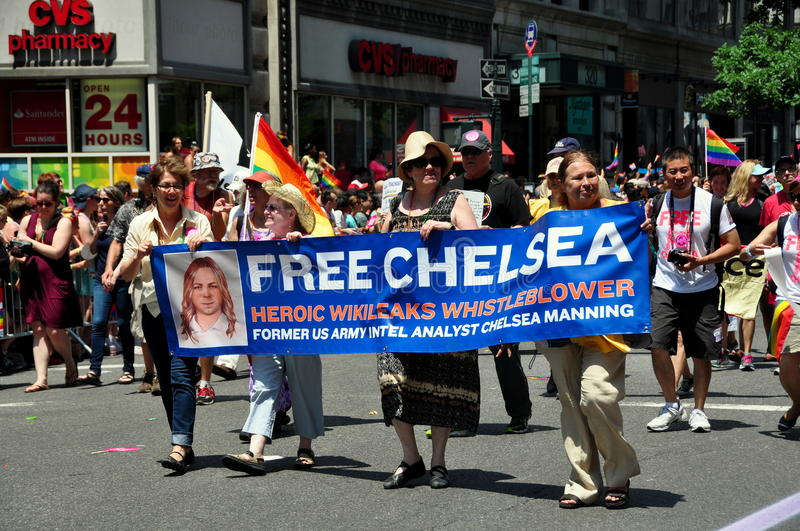 NYC: 2014 Gay Pride Parade. NYC: Marchers with banner for Chelsea Manning, a Wikileaks whistleblower, marching at the 2014 Gay Pride Parade on Fifth Avenue royalty free stock photo