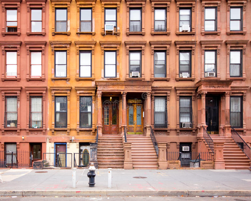 NYC Harlem Brownstones. NEW YORK CITY - OCT 26: Row of 1880's historic NYC brownstones in Harlem on Oct 26, 2012. This historic neighborhood in Manhattan is a