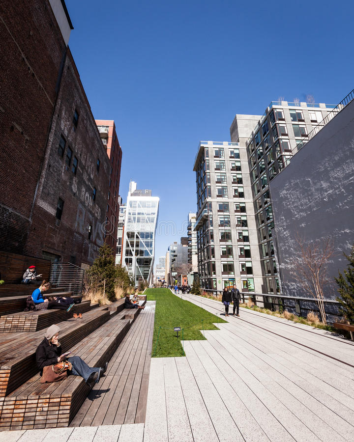 NYC High Line park. NEW YORK CITY, USA - 27 MARCH 2012: Candid view of the High Line park above the streets of New York City on a bright spring day royalty free stock photos