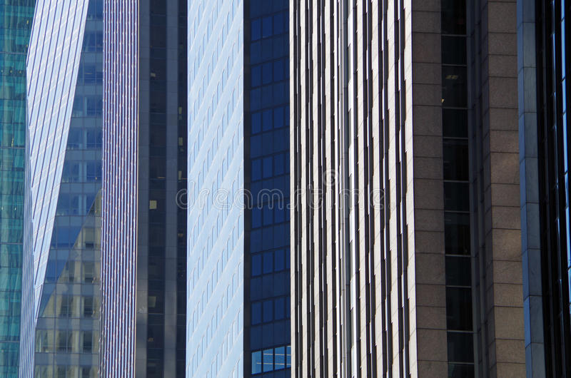 NYC intersecting high-rise buildings architectural background. Midtown Manhattan NYC intersecting high-rise buildings architectural background royalty free stock images