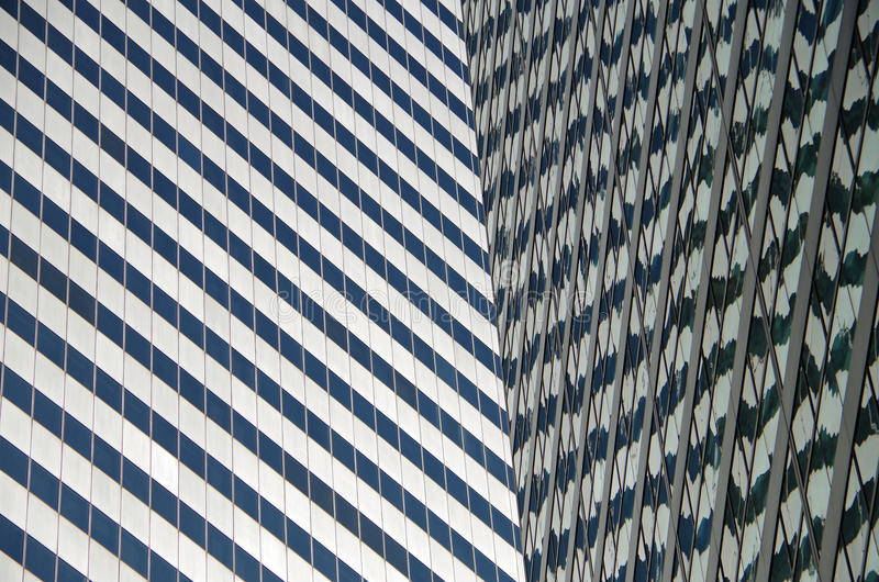 NYC intersecting high-rise buildings architectural reflections. Midtown Manhattan NYC intersecting high-rise buildings architectural background reflections stock photography