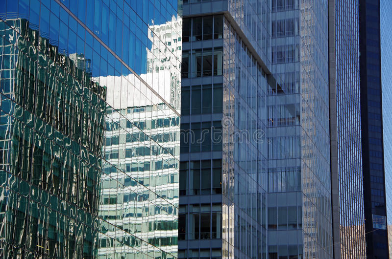 NYC intersecting high-rise buildings architectural reflections. Midtown Manhattan NYC intersecting high-rise buildings architectural background reflections stock photo
