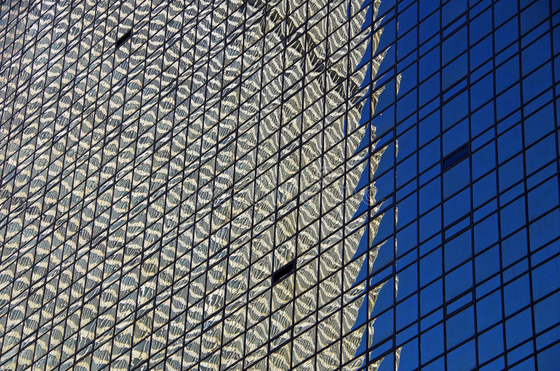 NYC intersecting high-rise buildings architectural reflections. Midtown Manhattan NYC intersecting high-rise buildings architectural background reflections stock image