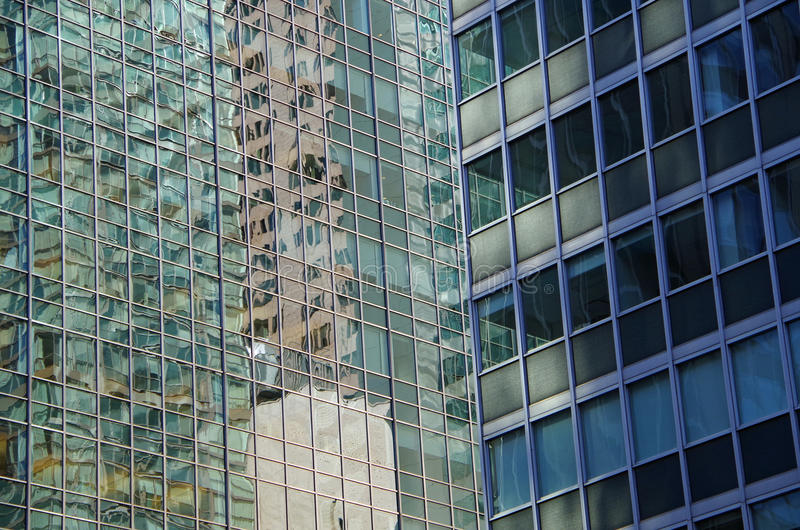 NYC intersecting high-rise buildings architectural reflections. Midtown Manhattan NYC intersecting high-rise buildings architectural background reflections royalty free stock photos