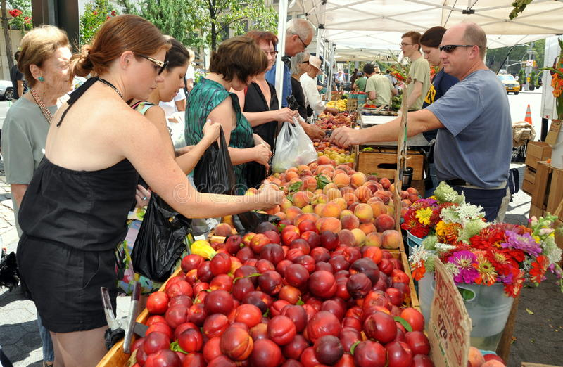 NYC: Lincoln Square Farrmer's Market. Shoppers flock to the busy Lincoln Square Farmer's Market at Broadway and 66th Street in New York City to buy farm fresh stock image
